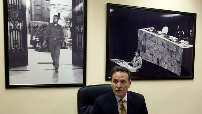 "Cuba's Deputy Director of U.S. Affairs Gustavo Machin speaks to reporters at the Foreign Ministry in Havana, Cuba, on Sept. 28, 2016, backdropped by framed images of Fidel Castro, left, and Ernesto ""Che"" Guevara."