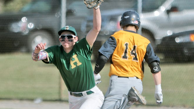 Howell's Austin Palo, left, pitched his team to a 7-0 win over Hartland on Wednesday. The two schools split a doubleheader.