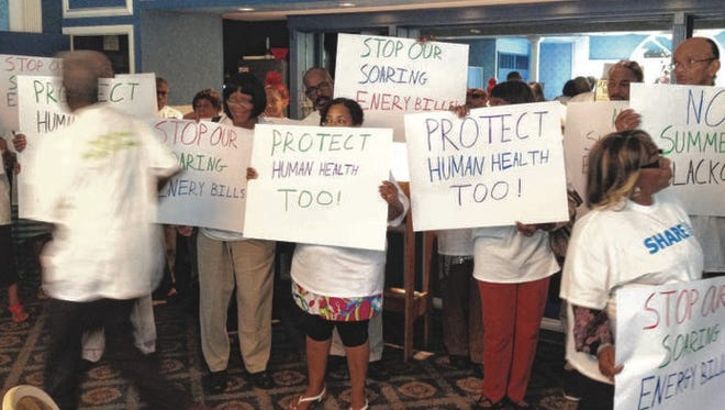 Members of Safe Healthy Affordable Reliable Energy protest the proposed summer closings of the Indian Point nuclear power plants at a rally before a state Department of Environmental Conservation hearing on the idea in Cortlandt on Tuesday, July 22, 2014.