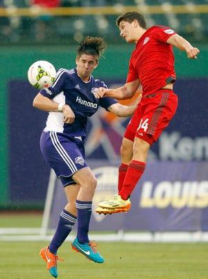 Louisville FC's Matt Fondy (9) battles pressure from Toronto FC's defense during their game at Louisville Slugger Field in Louisville, Kentucky.         May 16, 2015
