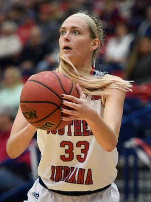 University of Southern Indiana's Kaydie Grooms (33) looks to pass as the USI Screaming Eagles play the Bellarmine Knights at USI's Physical Activities Center Saturday, February 10, 2018.