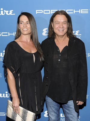 FILE - Musician Eddie Van Halen and his wife Janie Liszewski attend the Esquire 80th Anniversary and Network Launch Event in New York on Sept. 17, 2013. Van Halen, who had battled cancer, died Tuesday, Oct. 6, 2020. He was 65.