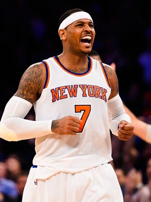 Carmelo Anthony of the Knicks celebrates after making a 3-pointer that tied the game with the Jazz late in the fourth quarter Friday night, but Utah hit a shot at the buzzer as the Knicks lost their seventh straight game.