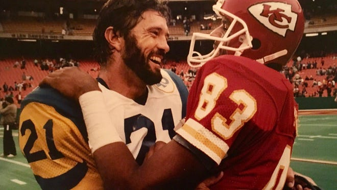 Former Los Angeles Rams star defensive back Nolan Cromwell (left) jokes with former Kansas City Chiefs receiver Stephone Paige after the Rams' 1985 game at Arrowhead Stadium.
