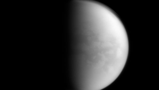 This undated image provided by NASA shows Saturn's largest moon, Titan. NASA's Cassini spacecraft has detected the presence of a plastic ingredient in Titan's atmosphere, the first time the chemical has been found in a world other than Earth.