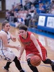 Bucyrus' Isidora Burling drives to the basket.