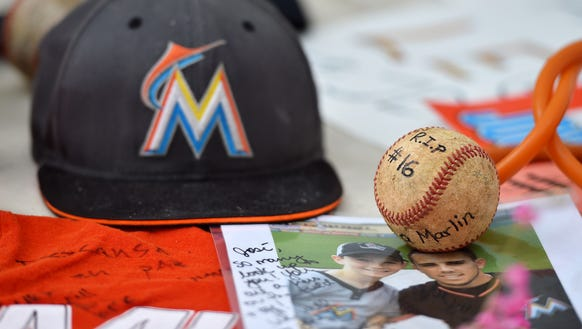 A memorial of signed shirts and hats are placed outside