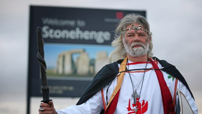 King Arthur Pendragon, a senior Druid, begins a protest march from the old Stonehenge visitor center to the recently opened new one.