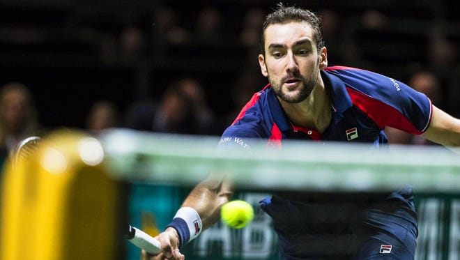 Marin Cilic of Croatia in action against Jo-Wilfried Tsonga of France during their quarterfinal match of the World Tennis Tournament in Rotterdam.
