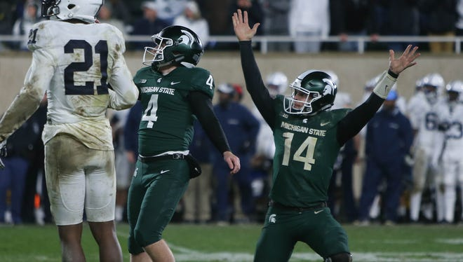 Michigan State kicker Matt Coghlin and quarterback Brian Lewerke react after Coghlin's game-winning field goal against Penn State on Saturday in East Lansing.