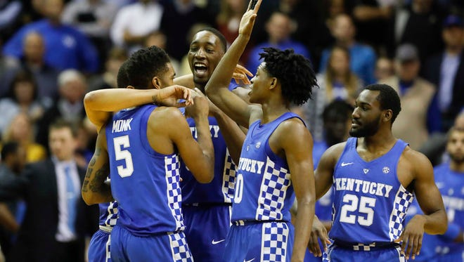 Kentucky Wildcats guard Malik Monk (5), guard De'Aaron Fox (0), forward Bam Adebayo (3) and guard Dominique Hawkins (25) celebrate during the game against the Vanderbilt Commodores in the second half at Memorial Gymnasium on Jan. 10.