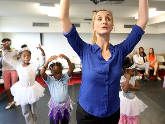 Blythe Roycroft, with the Cary Ballet Company, teaches students during Plie All Day, an outreach program that hopes to bring dance to women's shelters throughout the Triangle, April 20, 2017, at the women's shelter for the Durham Rescue Mission.
