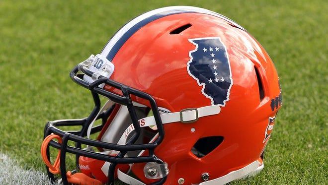 Illinois Fighting Illini helmet on the field before the game against the Purdue Boilermakers at Ross Ade Stadium.