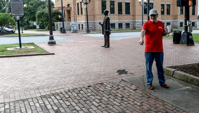 "Downtown resident Eddie Wilson of Anderson looks at a space where food trucks have parked to sell items between the Historic Courthouse and Anderson County Courthouse in downtown Anderson. ""She was here for about two weeks. I hoped it would work, but you have to put the time in it,"" Wilson said."
