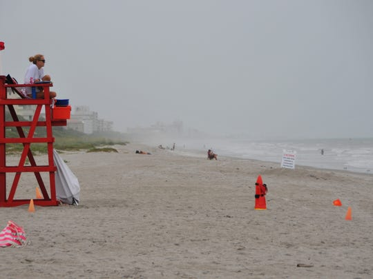 What would ususally be a busy beach day, lifeguards at the boardwalk at Indialantic were flying the red high hazard flag and guarding and almost deserted beach. Tropical Storm Colin spared Brevard for most of the day with just warm wind and high humidity.