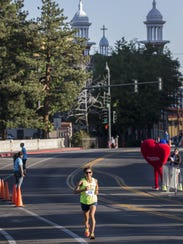 Ramona Sanchez runs down Arlington Ave. during the
