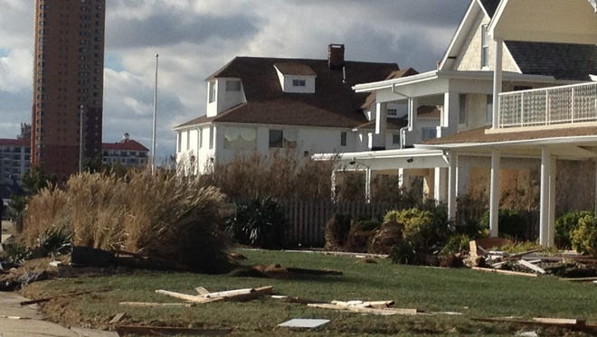 Debris in front of oceanfront houses in Allenhurst just after superstorm Sandy struck the coast.