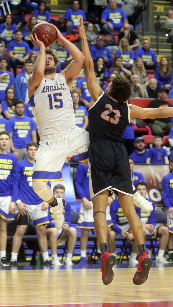 Julian McGarvey of Ardsley shoots over Avery Deas of