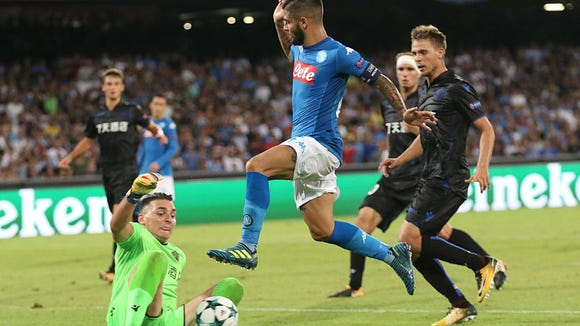 Lorenzo Insigne (C) of SSC Napoli in action  during