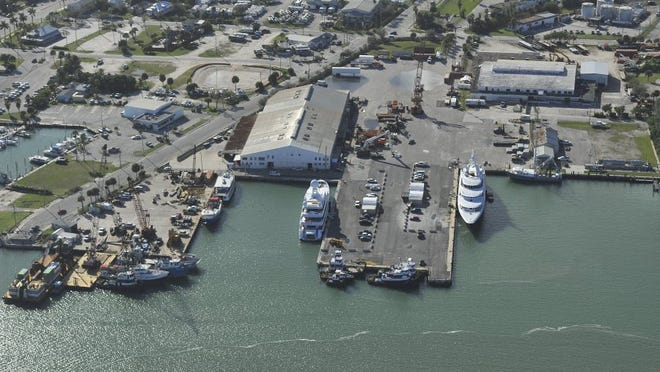 Two super yachts are seen Jan. 7, 2016, at the Port of Fort Pierce (center) and Fisherman's Wharf (left) along the Indian River Lagoon.