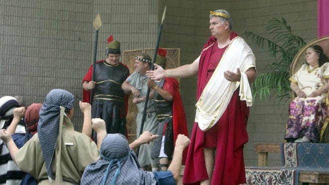 GEORGE TULEY/SPECIAL TO THE CALLER-TIMES Randy Kolanda (as Pontius Pilot) (C) faces an angry mob that demands a condemned criminal Barabbas (Bobby Fellows - left) be set free and Jesus instead should be crucified at Cole Park in Corpus Christi, Sunday, March 27, 2016. At far right is Cecilia Cashion as the wife of Pilot.