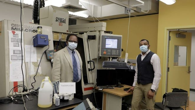 Drs. Anthony Okafor (L) and Monday Okoronkwo (R) are developing a soybean-based cutting fluid to benefit manufacturers, workers and the environment.