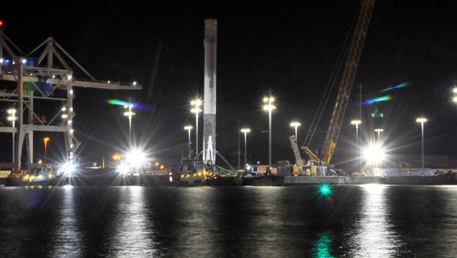 SpaceX's Falcon 9 rocket arrives at Port Canaveral before dawn on Tuesday, April 12, 2016.