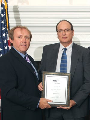 From left: John Cortlett, director of Government Affairs & Traffic Safety for AAA Northeast, presents Platinum Award for traffic safety to Thomas Soyk, White Plains deputy parking and traffic commissioner.