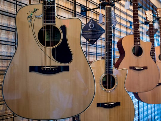 Guitars at Elite Music in downtown Montgomery, Ala. on Tuesday October 24, 2017.