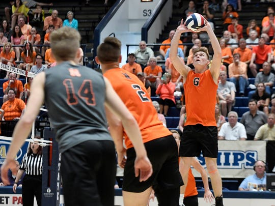 Northeastern setter Austin Richards, shown here putting the ball up for a kill attempt for teammate Zech Sanderson last season, returns for the Bobcats. Northeastern will try for its seventh straight state title, this time in Class 3-A. DISPATCH FILE PHOTO