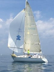 """Co-owner Chris Benedict of Plymouth and the other members of the crew onboard the """"Shape"""" sailed to a fourth straight Mackinac victory."""