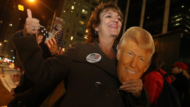 Donald Trump supporters Vickie Bruni of New Jersey cheers as the polls come in for Trump outside of the Hilton hotel in Midtown on Tuesday, November 8, 2016.