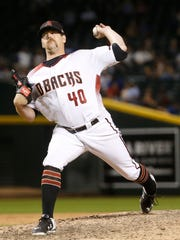 Diamondbacks Andrew Chafin (40) pitches in relief against