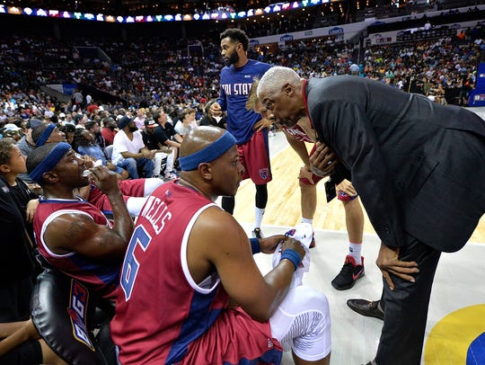 Coach Julius Erving of Tri-State huddles with his team