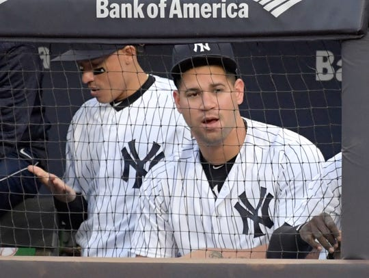 New York Yankees catcher Gary Sanchez watches from