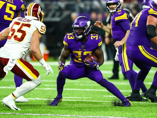 Minnesota Vikings running back Dalvin Cook (33) runs with the ball in the fourth quarter against the Washington Redskins at U.S. Bank Stadium.