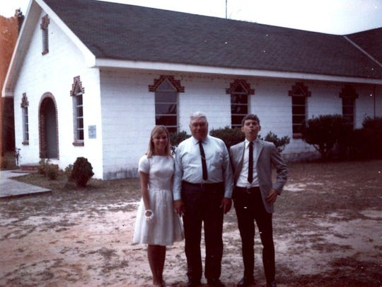 Lynn Boland, town constable Myers Williams and Jeffery Boland at the Wacissa church.