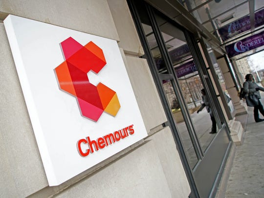 A pedestrian leaves Chemours building in Rodney Square