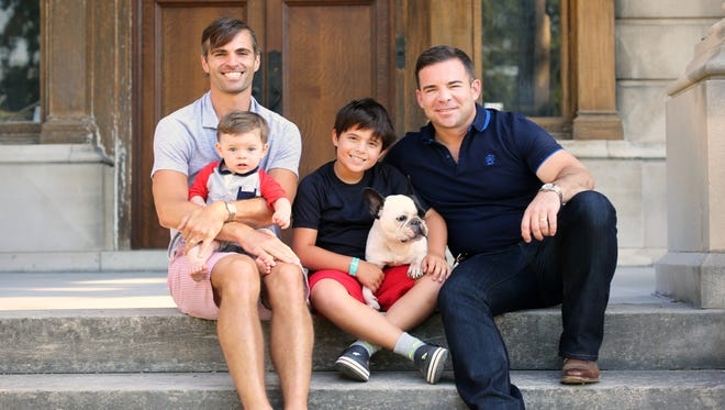 Jimmy Musuraca (left) and husband,Ryan Messer, now own this 1897 North Avondale home. They are rehabbing it for their growing family, Olivier, 10 months, Anderson, 8, and Jacques, the family French bulldog. They are expecting a little girl in December.