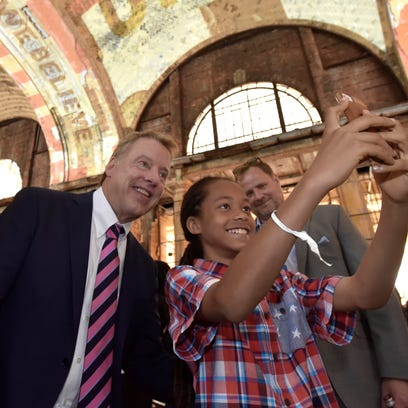 King Moore, 11, of Detroit, takes a selfie with Ford
