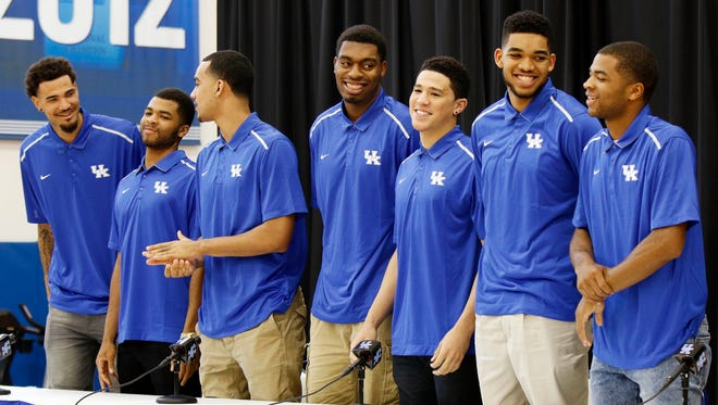 From left, Kentucky NCAA college basketball players Willie Cauley-Stein, Andrew Harrison, Trey Lyles, Dakari Johnson, Devon Booker, Karl-Anthony Towns and Aaron Harrison stand during a news conference where they announced their intent to place their names in the NBA draft at the Joe Craft Center, Thursday, April 9, 2015, in Lexington, Ky.