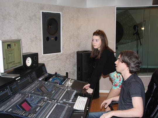 Sofi K works in the studio with her record producer,