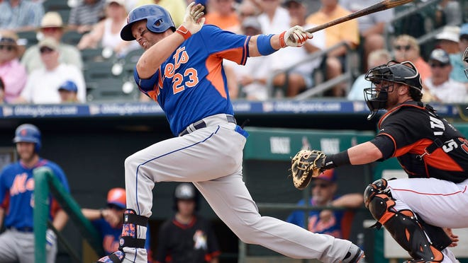Mets left fielder Michael Cuddyer connects for an RBI base hit against the Miami Marlins.