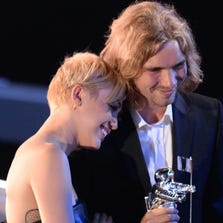 My Friend's Place representative Jesse (R) accepts Video of the Year with singer Miley Cyrus for 'Wrecking Ball' on stage at the MTV Video Music Awards (VMA), August 24, 2014 at The Forum in Inglewood, California.