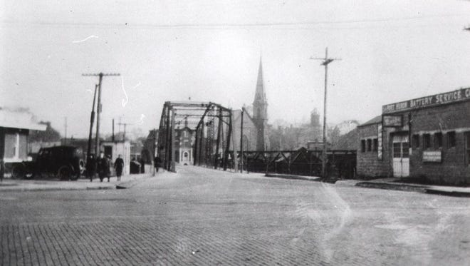 This 1922 photo shows the Seventh Street bridge with a view of the First Baptist Church in the background.