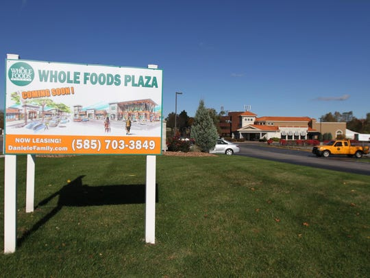 A sign advertises the proposed Whole Foods Center on