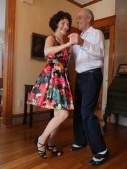 Ed Berkel and his wife Bena Silber, swing dance in