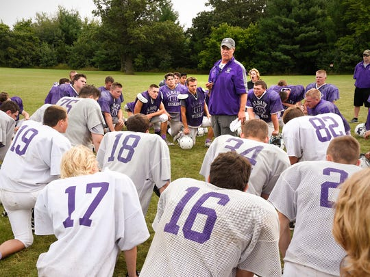 Albany head coach Mike Kleinschmidt talks  with players during practice Monday, Aug. 21, in Albany.