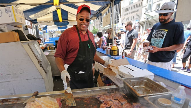 Charles Young, a chef with Wertheim's, works the grill at last year's Taste of Cincinnati. Wertheim's will also return this year.