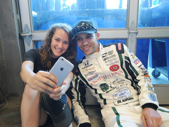 Bryan Clauson, right, poses for a photo with Lauren